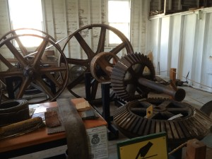 display of the king gear coming up from the vertical access turbine below the mill - with wooden teeth and the horizontal shaft with iron gears.  Wooden teeth are cheap, easily replaced and with break if something jams in the mill works - a built in planned weak spot