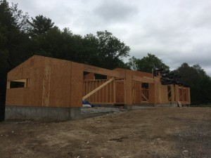 Progress continues forward. In the foreground is the wood/metal shop (aka - the Garage). In the middle ground is the carport and then the front door and living room area