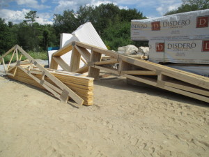 Trusses have arrived and are unpacked. These cover the mechanical space and the bedrooms. A complex and interesting design while still being cost effective. Note the flat plates - these are the connector plates that make the trusses much more affordable AND strong. According to the wiki page on the inventor of this technology, houses built in Florida with these connectors were much more likely to have survived Hurricane Andrew. https://en.wikipedia.org/wiki/John_Calvin_Jureit