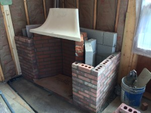 The Rumford Fireplace taking shape. The hearth will be a piece of bluestone. Note the chimney is square but is at an angle in the corner - Deck House designed it this way in order to angle the fire more towards the room instead of just sitting in the corner