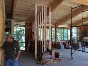 The view from the entry, across the future kitchen and into the computer/office area on the left and the living room on the right